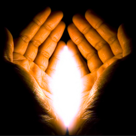 pair of hands with light