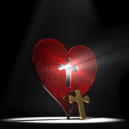Heart with with light shining through cross cut-out